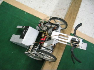 Wall Climbing Robot with Arm